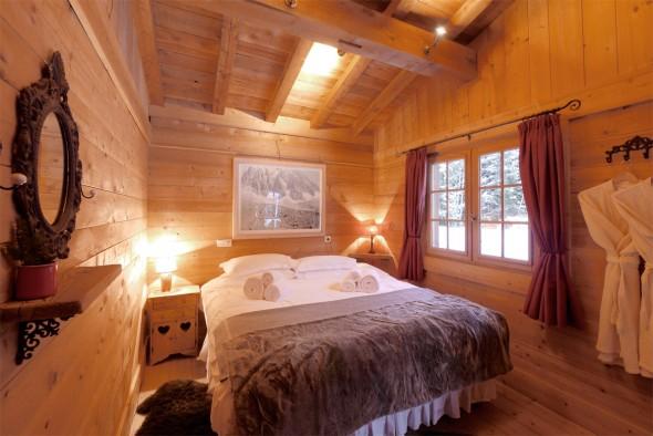 Upstairs bedroom with doors to balcony