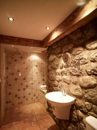 Downstairs wet room with exposed granite wall