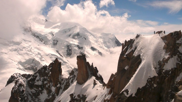 Mont Blanc and climbers on the Arête des Cosmiques, seen from the Aiguille du Midi