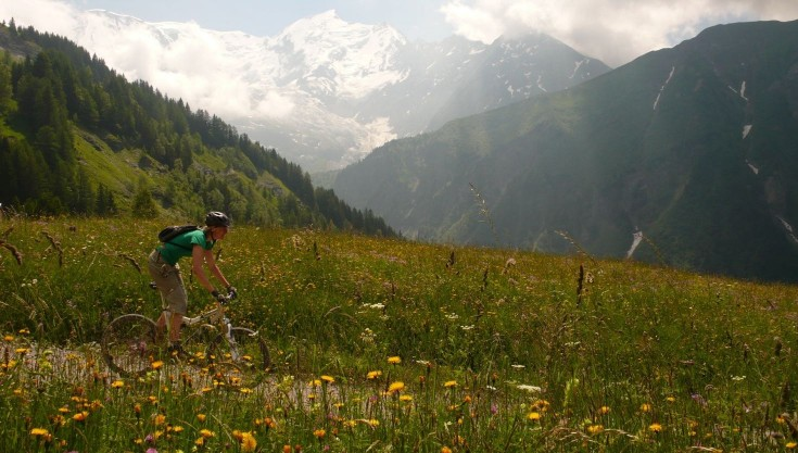 Mountain biking in summer in front of Mont Blanc